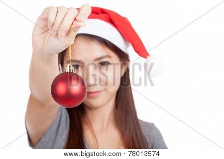 Asian Girl With Red Santa Hat Hold Bauble Focus At Bauble
