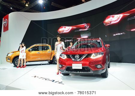 NONTHABURI - DECEMBER 1: Model Poses with New Nissan car Navara NP300 and x-trail at Thailand Intern