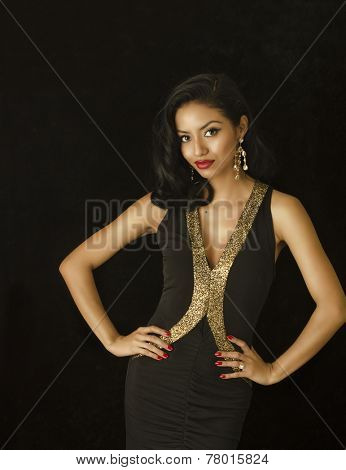 Beautiful exotic young woman in black dress