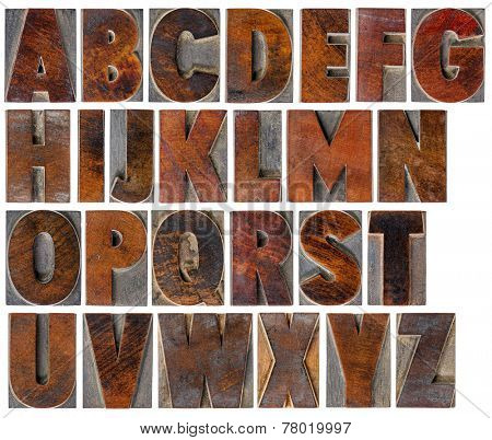 a complete English uppercase alphabet - a collage of 26 isolated antique wood letterpress printing blocks with ink patina
