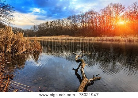 Sunset scene on lake in autumn time