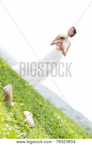 Young Bride Walking On Meadow