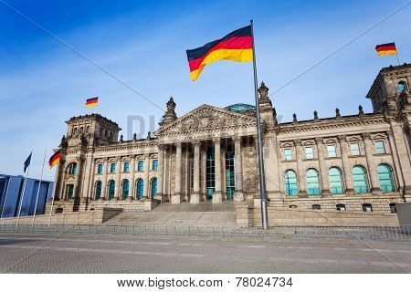 Reichstag facade view with German flags, Berlin