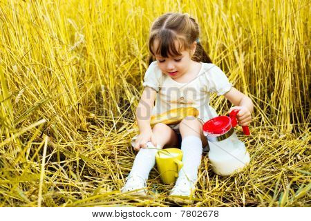 Girl Eating A Long Loaf And Milk