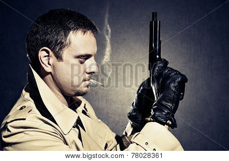 Killer Standing On Dark Background Recharging Gun