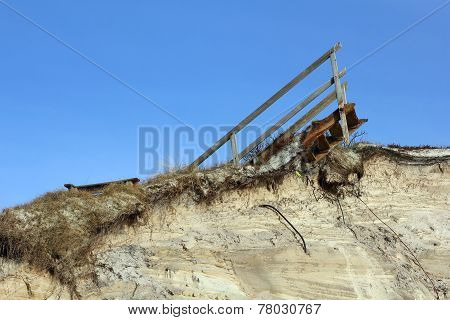 Remains Of Wooden Stairs On A Destroyed Dune