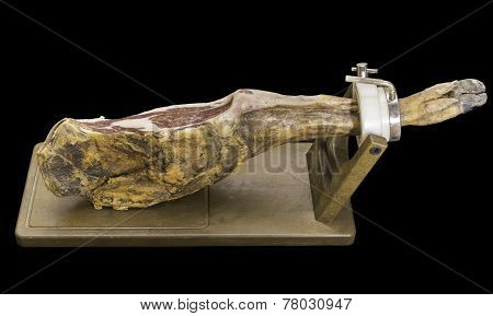 Cured serrano ham over black background, ultra wide angle