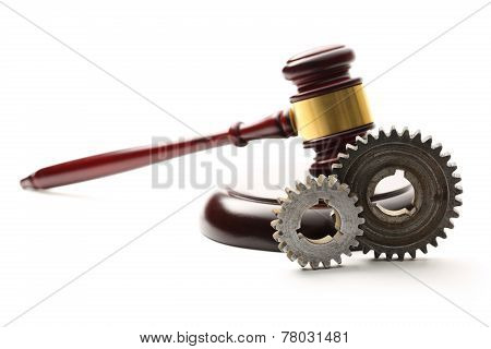 Steel Cogwheels On Judge's Wooden Gavel Background
