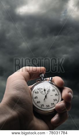 Hand Holding Stopwatch