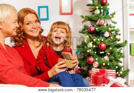Happy family New year presents opening