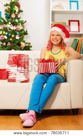 Happy blond smiling girl with presents