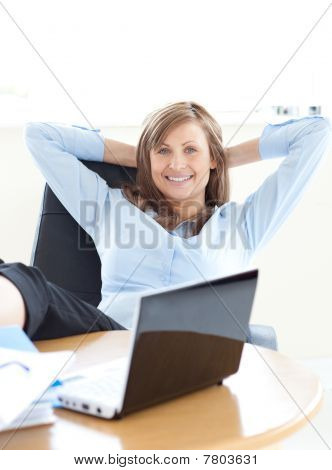 Smiling Businesswoman Looking At The Laptop