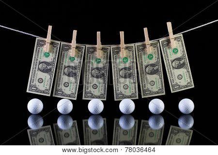 Dirty Us Dollar Banknotes And Golf Balls