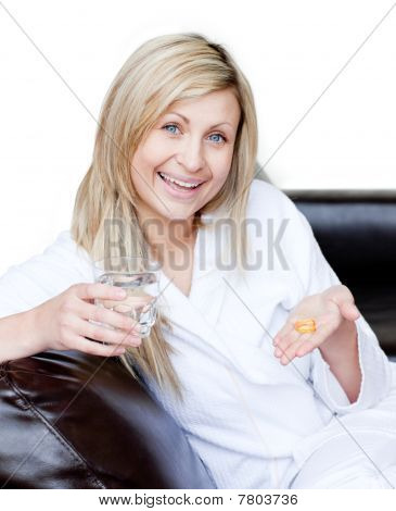 Happy Woman Holding Medicine