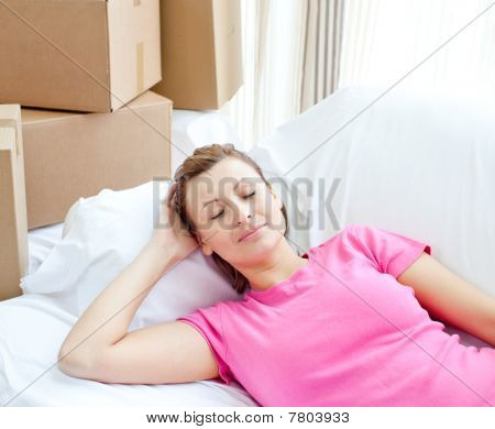 Sleeping Woman Relaxing On A Sofa With Boxes