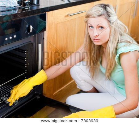 Portrait Of A Radiant Housewife Cleaning