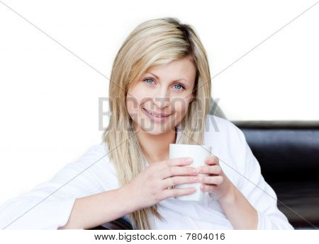 Self-assured Woman Holding A Cup Of Coffee