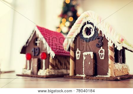 holidays, christmas, baking and sweets concept - closeup of beautiful gingerbread houses at home