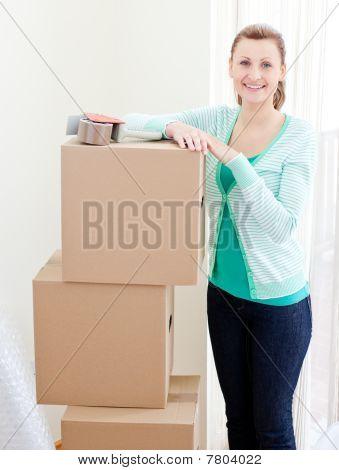 Beautiful Woman Closing Various Boxes