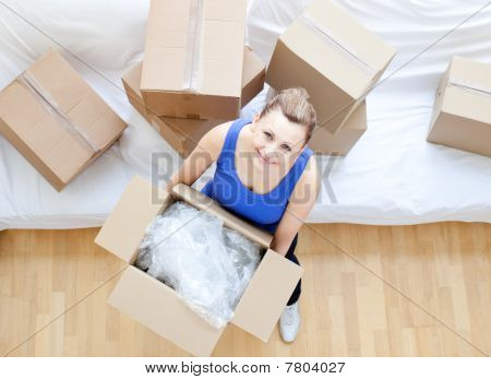 Delighted Woman Holding A Box