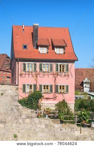 Old town house with pink shingles