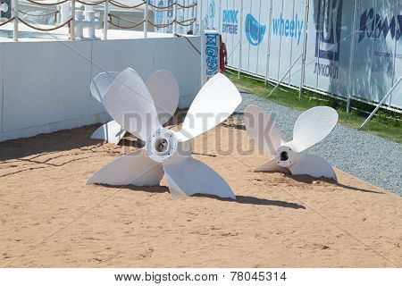 Perm, Russia - Jun 11, 2013: Decorative White Screws Buried In The Sand At Festival White Nights