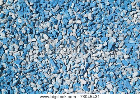 Background And Texture Of Small Placer Macadam Stone Colored In Blue