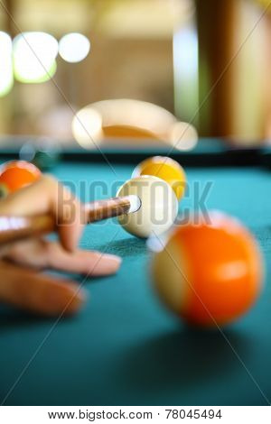 billiard balls and cuestick on the table