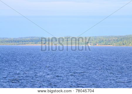View Of Grand Kama River Bank And Big Green Forest On Hot Sunny Day