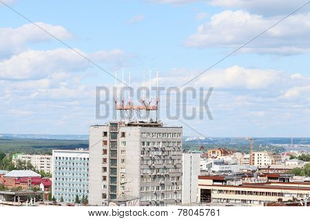Modern Apartment Buildings In Big City On Sunny Day With Forest In Background