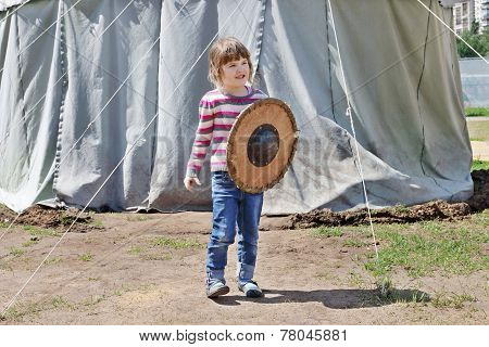 Pretty Happy Little Beautiful Girl In Striped Sweater Holding Shield