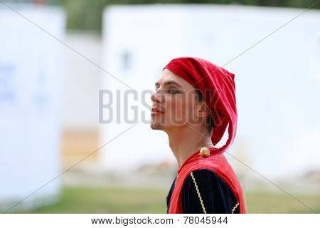 Male Clown With Red Hat With Forked Bells With Painted Lips And Eyes A