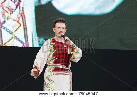 Men Singer Of Russian Folk Songs In National Dress Singing At Festival