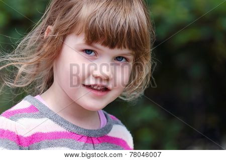 Girl In Striped Sweater Looking At Camera On Sunny Day