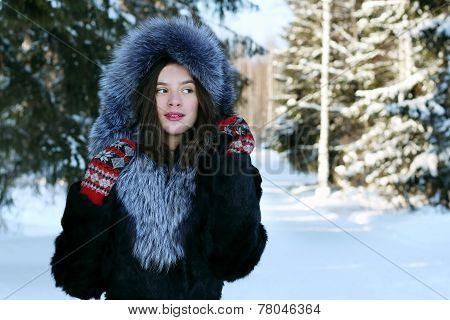 Girl In Fur Coat In Winter Forest
