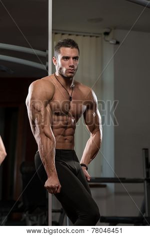 Young Man Performing Side Triceps Pose