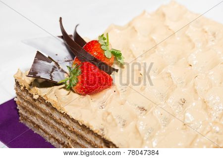 Walnut Cake With Strawberry And Chocolate Garnish