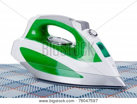 Iron On Ironing Board On A White Background