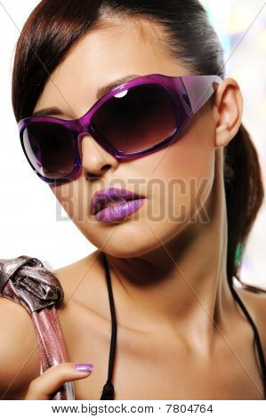 Beautiful Woman With Purple Fashion Sunglasses