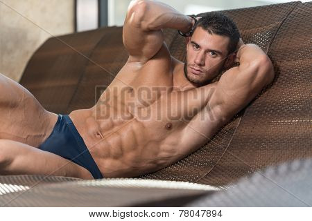 Young Athlete Resting On Sun Lounger