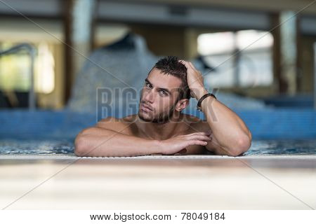 Male Swimmer Resting In Pool