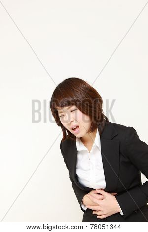 Japanese businesswoman suffers from stomachache