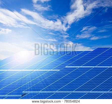 Sun Light And Solar Cell Panels  Against Beautiful Clear Blue Sky Use As Clean Electricity Power Of