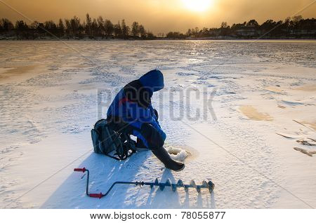 Ice Fisher With Ice Auger