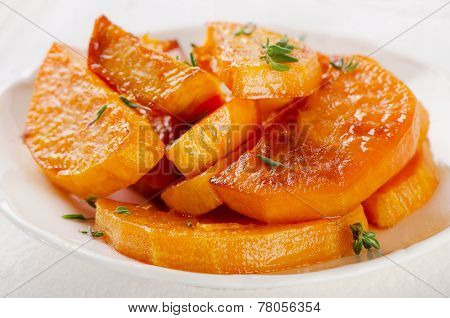 Baked Sweet Potato Wedges On A White Plate