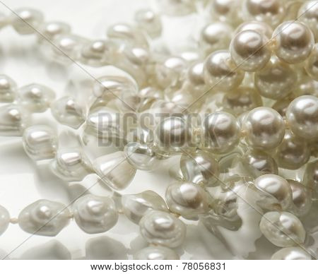 Shining String Of White Pearl In Water