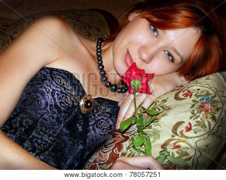 beautiful redhead girl with red rose