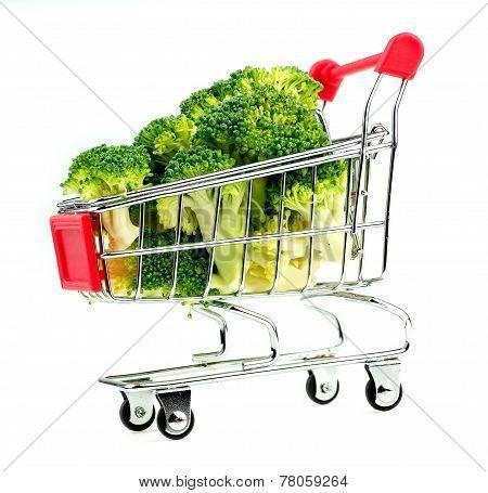 Horizontal View Of Organic Broccoli In Miniature Shopping Cart
