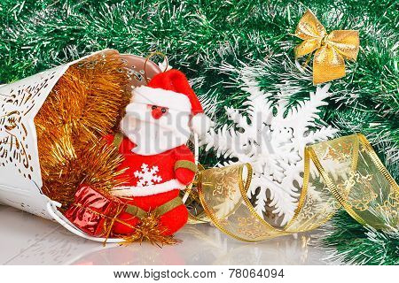 Santa Claus With White Bucket, Red Gift Box And White Snowflake