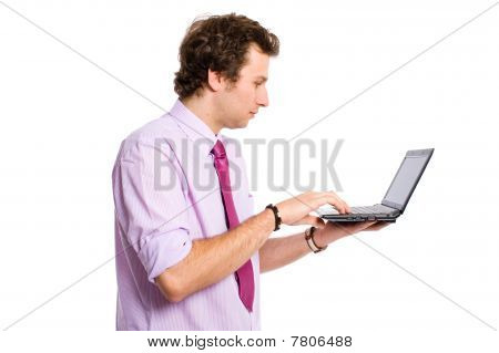 Young Adult Working On Small Laptop, Netbook, Isolated